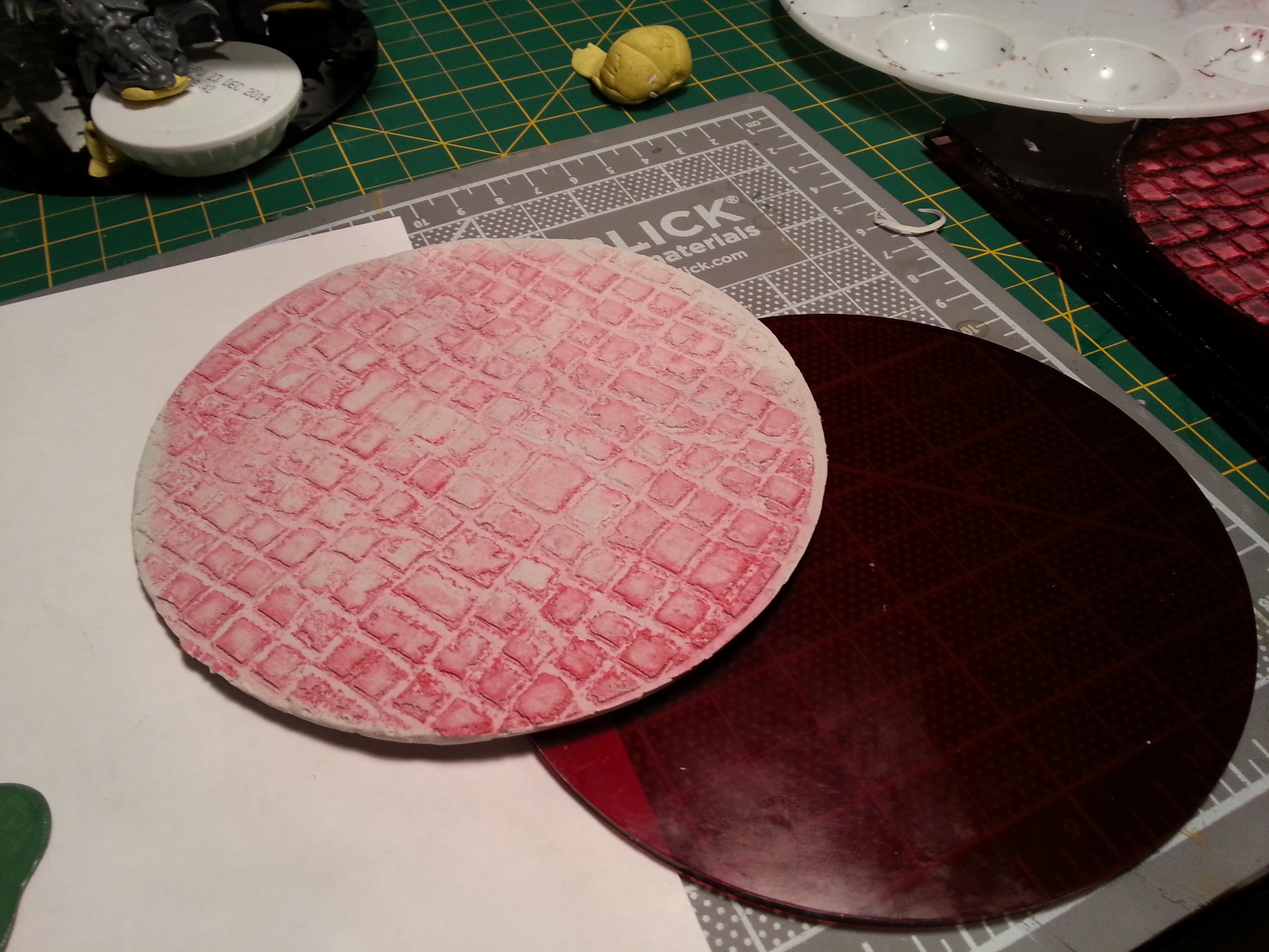 Barbie Step Eleven - Dried enough to handle, and the disk to which it will be glued. The red tint is due to traces of plastic dust left over from the laser engraving process, which I didn