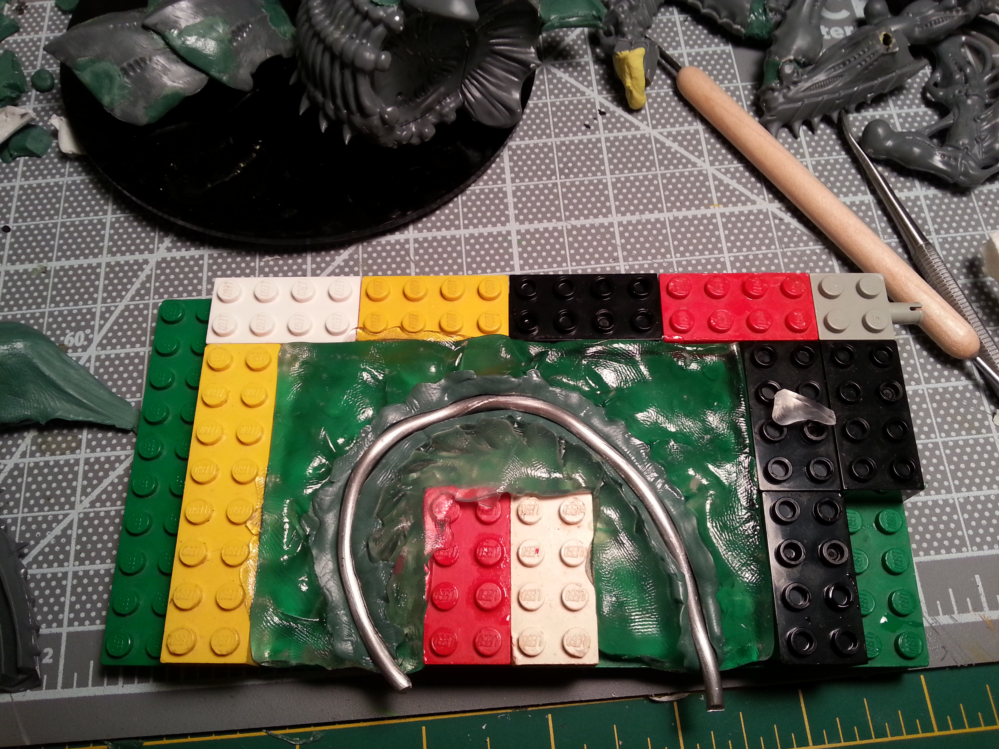 Barbie Step 8 - Bottom layer of greenstuff, with the armature bedded into it.